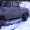 Два сумашедших УАЗа пробираются по бездорожью кавказских лесов.